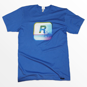 c6cf19a8 The official Rockstar logo gets a psychedelic hit with this dazzling yet  dusty multi-colored print, on a soft royal blue cotton tee.